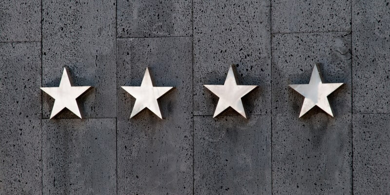 Four silver stars on a concrete wall